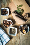 Some kinds of spice. Amomum tsao-ko,dried mushroom,pepper,anise and cinnamon on wood plank Stock Images