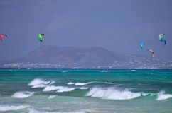 wave and kitesurfers Royalty Free Stock Photos