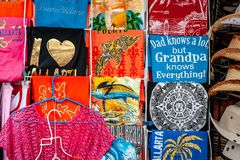 Kitschy T-Shirts from a Souvenir Shop. Some kitschy t-shirts arranged for sale at a tourist souvenir shop Stock Images
