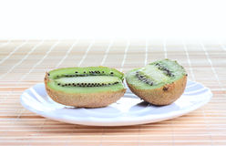 Some kiwi on the plate Stock Photography