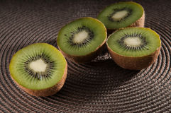 Some kiwi on the table. Some middle kiwi on the table royalty free stock photo