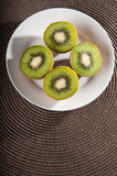 Some kiwi on the table. Some middle kiwi on the table royalty free stock images