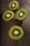 Some kiwi on the table. Some middle  kiwi on the table Stock Image