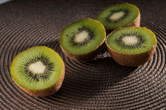 Some kiwi on the table. Some midlle kiwis on the table Stock Images