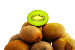 Some kiwi on white background. One half of kiwi in the head of heap stock photography