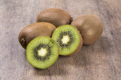 Some kiwis in a basket over a wooden surface. Fresh fruits Royalty Free Stock Photo