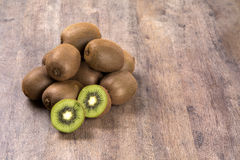 Some Kiwis In A Basket Over A Wooden Surface Stock Images