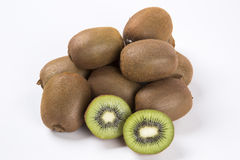 Some kiwis over a white background. Fresh fruits Stock Image