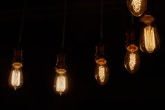 Some light bulbs on black. Background Stock Photos