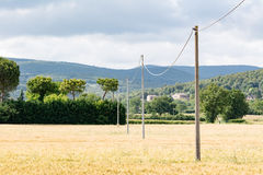 Some light poles in a field Royalty Free Stock Photography