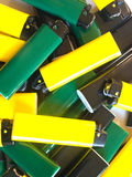 Some lighters. A pile of colorful lighters Stock Image