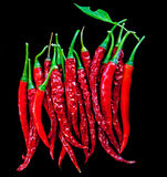 Some Like it HOT. Chillies placed and photographed on a black background Royalty Free Stock Photo