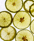 Some lime slices on white. Many lemon isolated on a white sheet Stock Photos