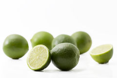 Some limes. And halfes on on white background Stock Images