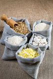 Some linen bags with ingredients. On canvas background Royalty Free Stock Images
