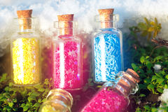 Some little glass bottles with dreams in the spring forest. Stock Photos