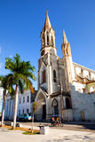 Some locals in front of the Cathedral  Iglesia de Nuestra Corazon de Sagrado Jesus. The Sacred Heart of Jesus Cathedral at Marti P Stock Photography