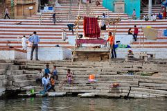 Locals hang out at a ghat in Varanasi, India. Some locals hang out at a ghat in Varanasi, India royalty free stock images