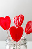 Some lollipops with heart shape into jar. Stock Images