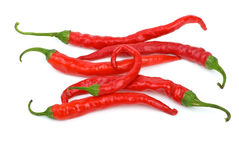 Some long curved red chili peppers Stock Images