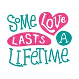 Some love lasts a lifetime. Love in Hearts. Valentine`s Day. Lettering. Quote. Stock Photo