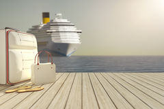 Some luggage and a cruise ship in the background Stock Photography