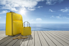 Some luggage on a wooden jetty Royalty Free Stock Photos