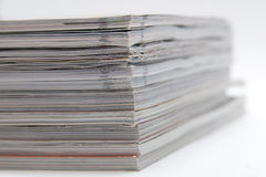 Some magazines. Isolated on gray royalty free stock photo