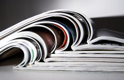 Some magazines with dramatic light. Some magazines isolated, with dramatic light Stock Photo