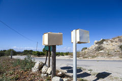 Some mail boxes on roadside. Mounted on wood stake Royalty Free Stock Photos