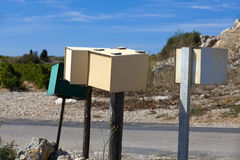 Some mailboxes. On roadside mounted on wood stake Royalty Free Stock Photo
