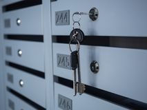 Some Mailboxes in an apartment building in a new building house.  stock images