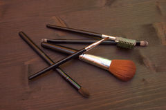Some makeup brushes on wood seen from above. Some makeup brushes on a wooden table seen from above Stock Photography