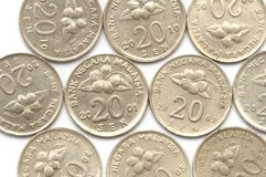 Some Malaysia twenty cent coins. Several Malaysia twenty cent coins with hibiscus flower plant imprint issued in the years 2005, 2004, 2010, 2001, 2002 and 1993 Royalty Free Stock Photos