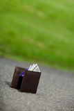 Some man lost wallet. Lost man wallet at the park sidewalk Stock Photo