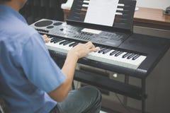 Some man playing keyboard music instrument Royalty Free Stock Image