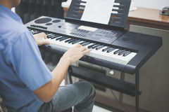 Some man playing keyboard music instrument Royalty Free Stock Images