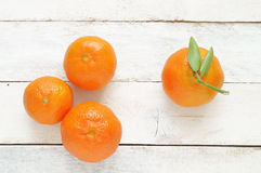 Some mandarines on a white wooden table Royalty Free Stock Photo