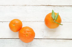 Some mandarines on a white wooden table Stock Image