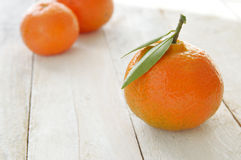 Some mandarines on a white wooden table Stock Photography