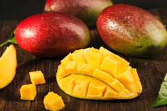 Some mango on wood boards. Sliced ripe mango on wooded board. Some mango on background Royalty Free Stock Image