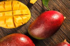 Some mango on wooded board. Stock Images