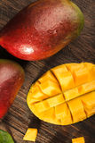 Some mango on wooded board. Stock Photos