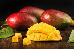 Some mango on wooded board. Royalty Free Stock Images