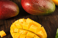 Some mango on wooded board. Stock Image