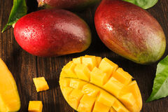 Some mango on wooded board. Royalty Free Stock Image