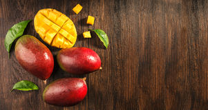 Some mango on wooded board. Stock Photo