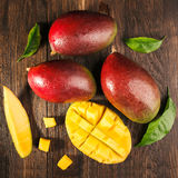 Some mango on wooded board. Royalty Free Stock Photos