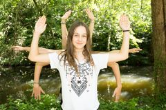 Some many girls playing in the summer in the park having fun doing yoga from many hands shiva. Meditation royalty free stock photo