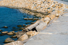 Some marine backwater and stone breakwater. Some marine backwater and stone breakwater bright day Stock Photo